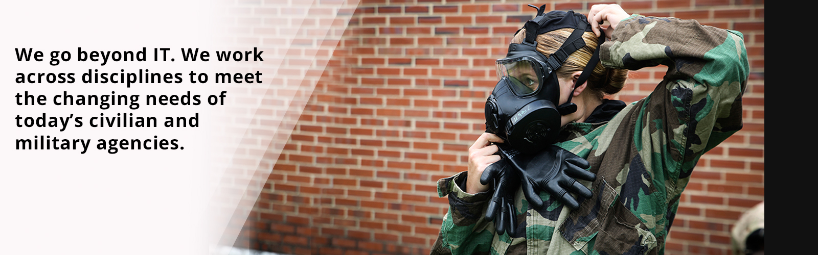 Lance Cpl. Amanda Degrave, a Marine with Marine Air Ground Task Force Materiel Distribution Company, 2nd Supply Battalion, adjusts her gas mask during a Chemical, Biological, Radiological and Nuclear decontamination course aboard Camp Lejeune, N.C., July 16, 2015